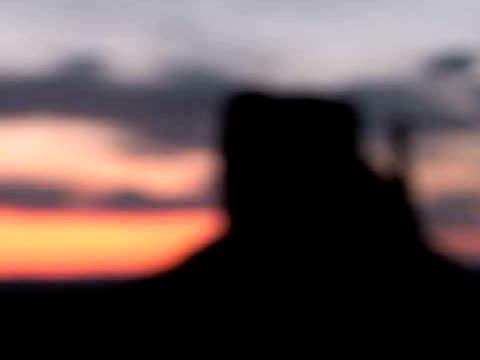 ms, focusing, silhouette of west mitten butte at sunrise, monument valley tribal park, arizona/utah, usa - butte rocky outcrop stock videos & royalty-free footage
