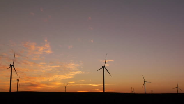 WS Silhouette of wind turbine against sky at sunset/ Kewaunee, Illinois