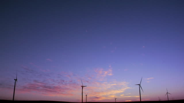 ws silhouette of wind turbines against sky at sunset/ kewaunee, illinois - small group of objects stock videos & royalty-free footage