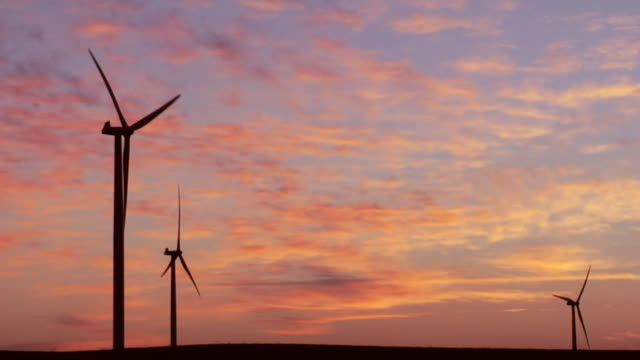 ms silhouette of wind turbines against sky at sunset/ kewaunee, illinois - small group of objects stock videos & royalty-free footage