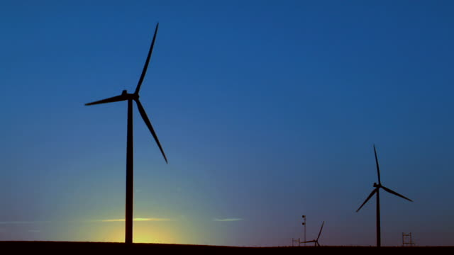 ws silhouette of wind turbines against sky/ kewaunee, illinois - small group of objects stock videos & royalty-free footage