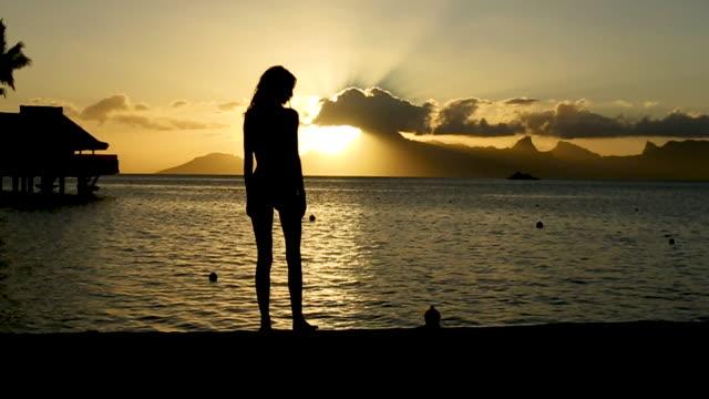 silhouette of woman on tahiti beach at sunset, wide - tahiti stock videos & royalty-free footage
