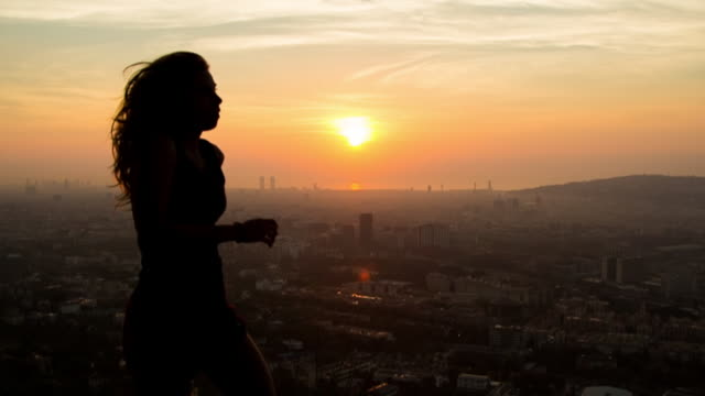 SLOW MO: Silhouette of woman running
