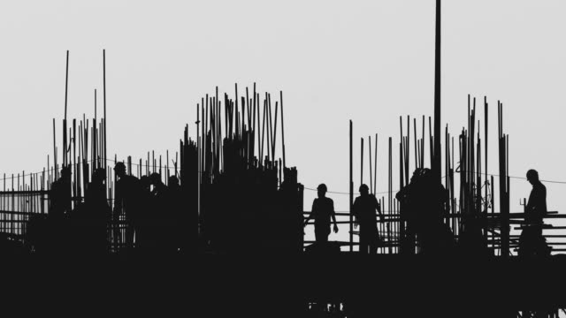 Silhouette of Workers at Construction Site