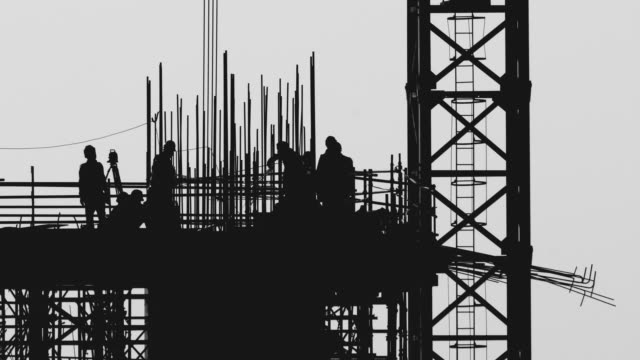 silhouette of workers at construction site - scaffolding stock videos & royalty-free footage