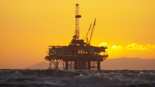 silhouette oil rig coastal platform at sunset california - offshore platform stock videos & royalty-free footage