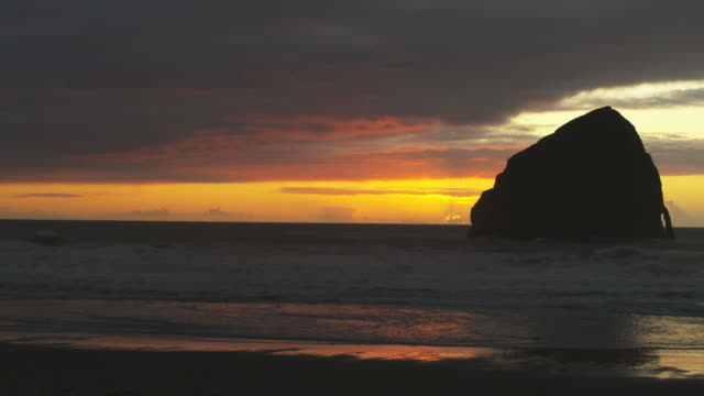 silhouette orange and red coastal sunset on the ocean - pacific city stock videos & royalty-free footage