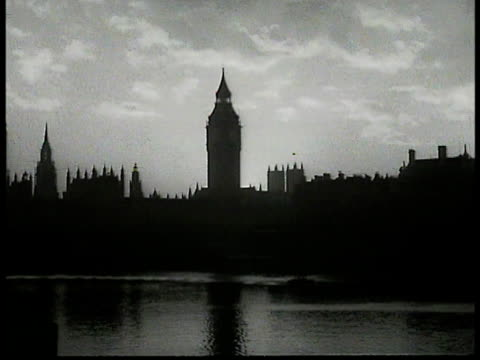 silhouette palace of westminster ms man in religious garments possibly archbishop of westminster william godfrey lowering crown onto man in ceremony... - lowering stock videos & royalty-free footage
