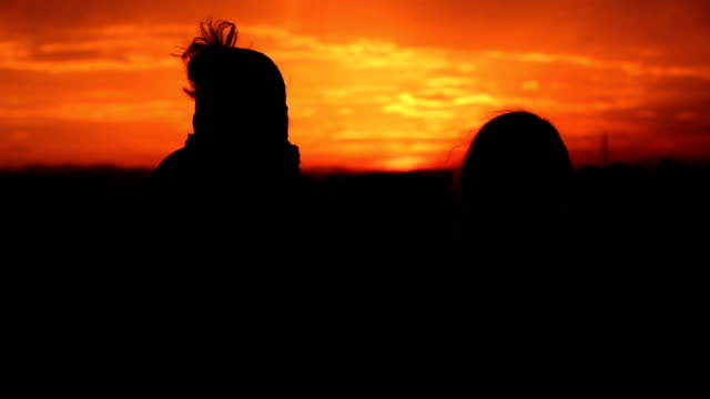 silhouette people at sunset the are happy - female friendship stock videos & royalty-free footage