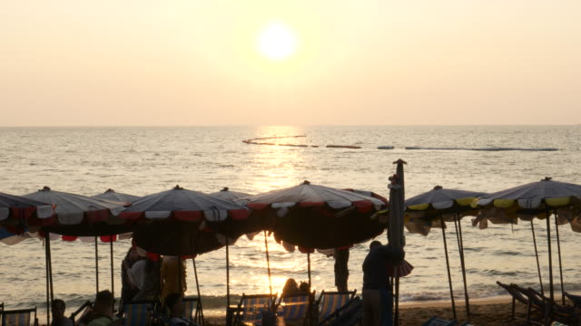 silhouette people in pattaya beach at sunrise - realisticfilm stock videos and b-roll footage