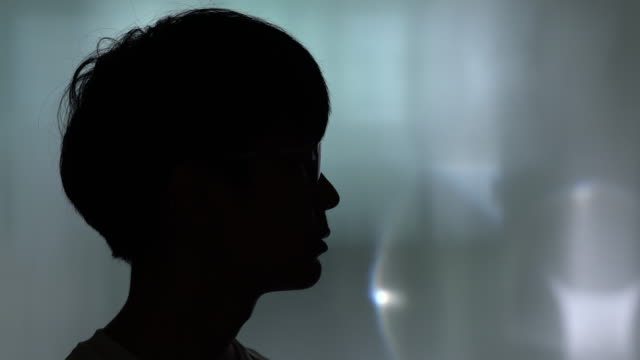 silhouette portrait of a young man - back lit stock videos & royalty-free footage