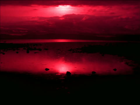 silhouette rain drops falling onto lake / lake tahoe, california - romantische stimmung stock-videos und b-roll-filmmaterial