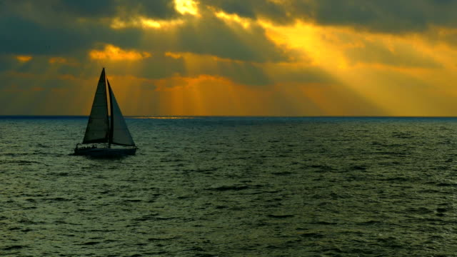 silhouette sailing yacht at sunset - yacht stock videos & royalty-free footage