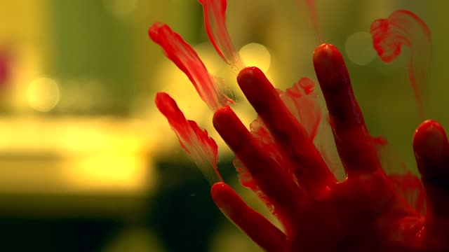 silhouette scared girl hand with red blood behind a glass door, horror background. - killing stock videos & royalty-free footage