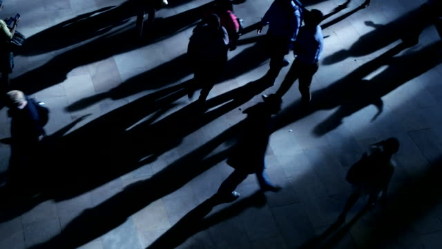 silhouette shadow of unrecognizable business people walking in the city at rush hour time