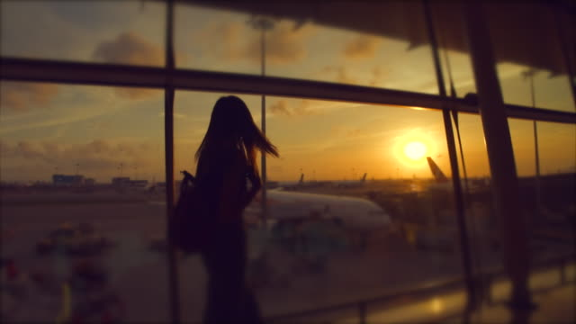 silhouette style passengers are walking in the departure hall. - airplane stock videos & royalty-free footage