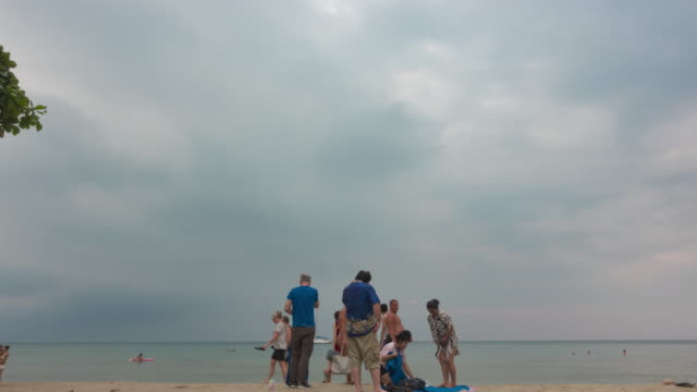 silhouette tourist, the crowd on clean sea surface at sunset. - koh chang stock videos and b-roll footage