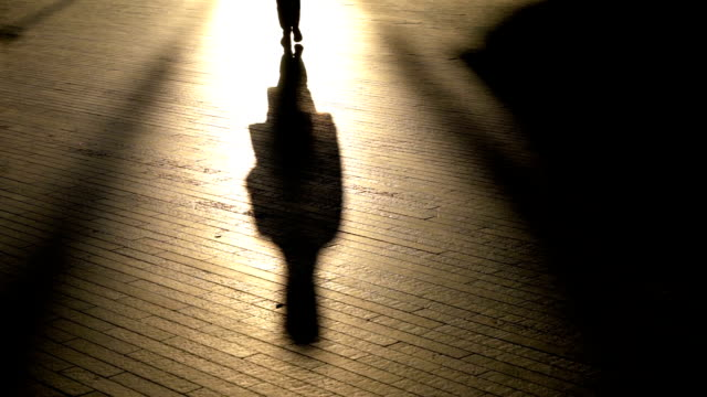 silhouette unrecognizable person walking in slow motion - human foot stock videos & royalty-free footage
