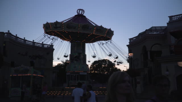 silhouette view: carousel in prater park  of vienna at twilight, austria - prater park stock videos & royalty-free footage