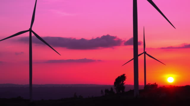 silhouette wind turbines farm at sunset - efficiency stock videos & royalty-free footage