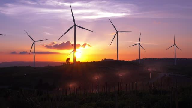 Silhouette Wind Turbines farm at sunset
