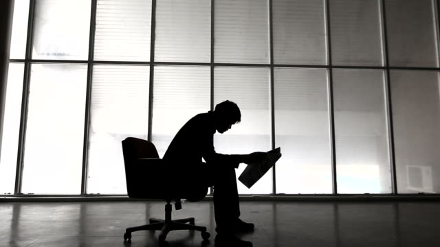 silhouette,businessman reviewing document - scolding stock videos & royalty-free footage
