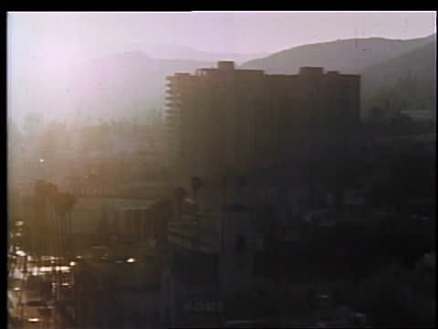 1970 silhouetted building + hills in smoggy los angeles / educational - 1970 stock videos & royalty-free footage
