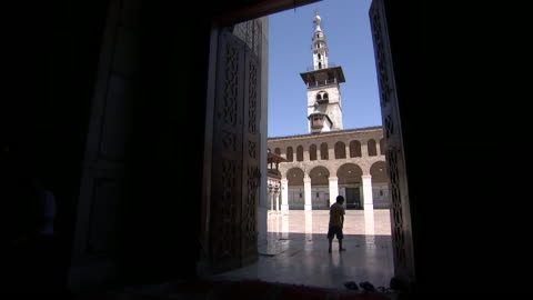 silhouetted children walk through a hallway into the umayyad mosque courtyard in damascus, syria on august 18, 2018. - religion or spirituality stock videos & royalty-free footage