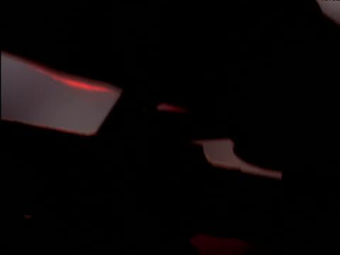 vidéos et rushes de silhouetted hand pulls lever on fire hose nozzle\n - levier de contrôle