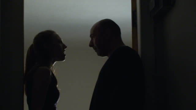 silhouetted man and woman arguing in hallway - blame stock videos & royalty-free footage