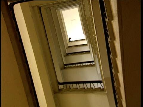 silhouetted man emerges over the top of stairwell south africa - böja sig bildbanksvideor och videomaterial från bakom kulisserna