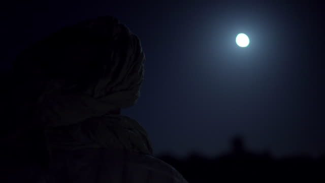 silhouetted man looks at the moon - reflection stock videos & royalty-free footage