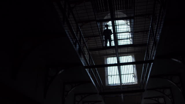 silhouetted man on jail - despair stock videos & royalty-free footage