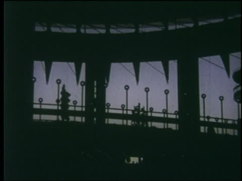 1964 silhouetted pavilion structure at dusk / ny world's fair - esposizione universale di new york video stock e b–roll