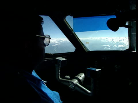 silhouetted pilot in cockpit of aeroplane flying on autopilot above pamir mountains central asia; 1996 - high up stock videos & royalty-free footage