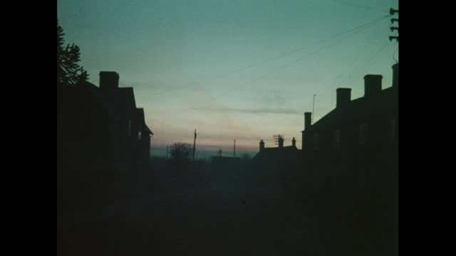 silhouetted scenes of a village, 1970s, uk - village stock videos & royalty-free footage