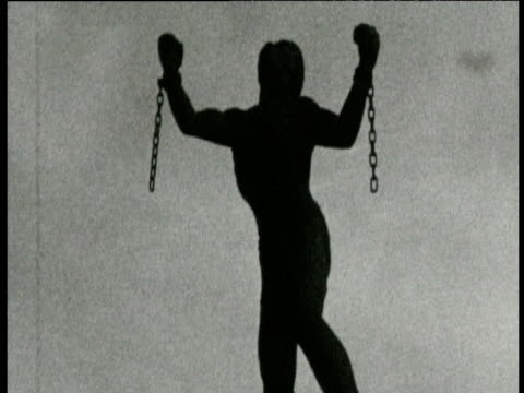 Silhouetted statue depicting slave with broken shackles