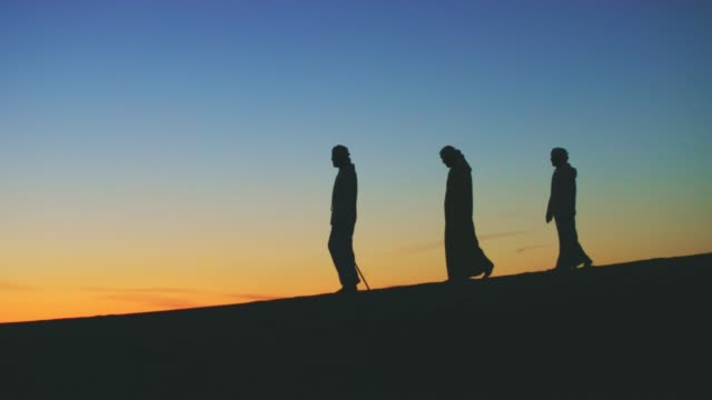 silhouettes of arabs walking on the dunes - the way forward stock videos & royalty-free footage