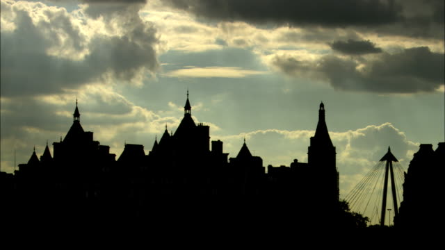 ms, silhouettes of buildings against sky, traffic in foreground, london, england - 2003 stock videos & royalty-free footage