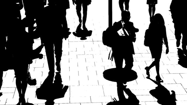 T/L B/W Silhouettes Of City People On The Move