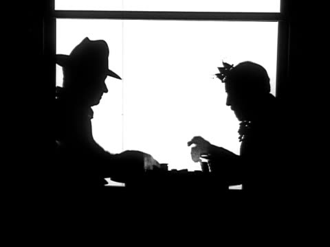 b/w, ms, silhouettes of cowboy and king playing cards, cowboy winning, 1924 - luck stock videos & royalty-free footage