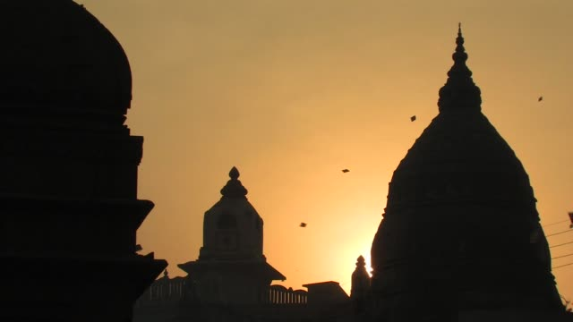 ms, silhouettes of domes and kites flying against golden sky at sunset, varanasi, uttar pradesh, india - temple building stock videos & royalty-free footage