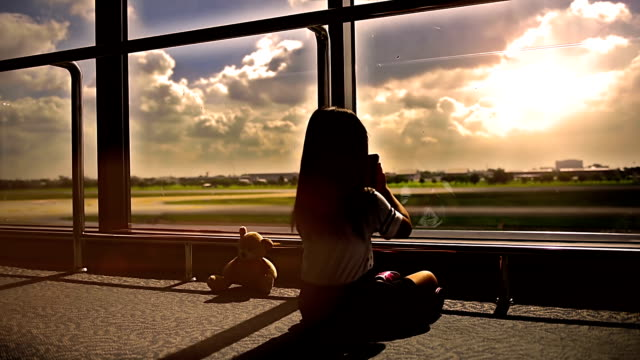 Silhouettes of girls playing in the Airport