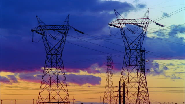 t/l ws silhouettes of high voltage electrical towers against sky at sunset, san joaquin valley, california, usa - electricity pylon stock videos & royalty-free footage
