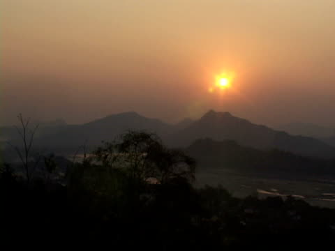 WS, Silhouettes of hills against golden sky at sunset, Vang- Vieng, Laos