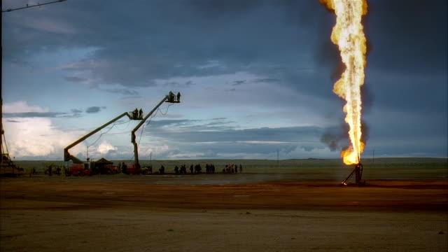 ws, reenactment silhouettes of marines at burning oil well, kuwait - 撮影現場点の映像素材/bロール