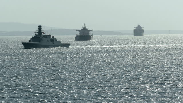 silhouettes of military and cargo ships in the dardanelles strait - warship stock videos & royalty-free footage