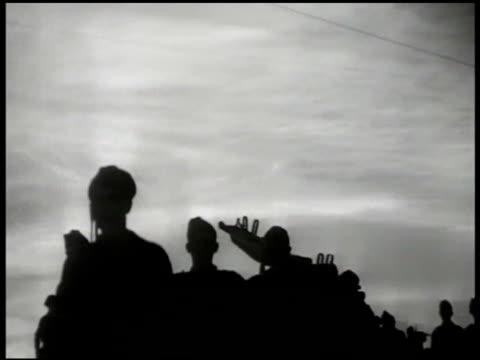 silhouettes of partisan soldiers walking vs yugoslavian soldiers running down war torn streets belgrade vs antitank artilleries firing ms sniper... - 旧ユーゴスラビア点の映像素材/bロール