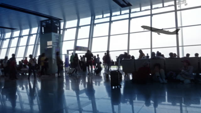 silhouettes of passenger in airport. - abitacolo video stock e b–roll