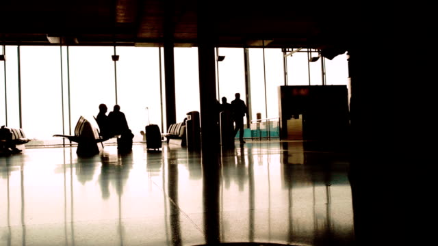 Silhouettes of passengers at the terminal airport